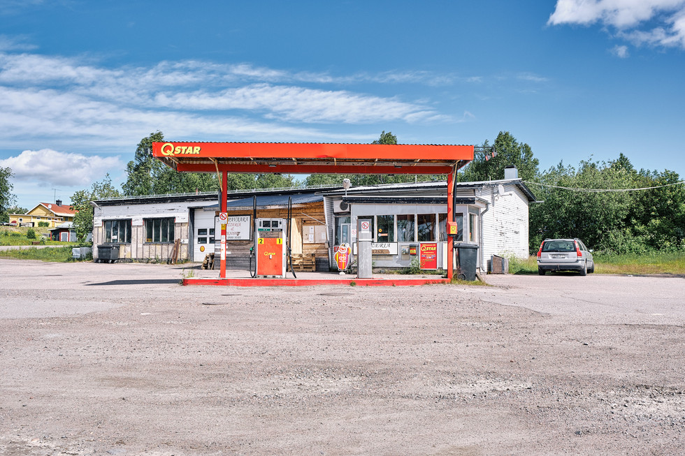 """SWEDEN / Svapavaara / 27.06.2019 / Petrol station with attached pizzeria in Svapavaara, a mining town in northern Sweden. As in the neighbouring town of Kiruna, the mining company LKAB is also based here. The ore from Kiruna is processed into pellets. In 1975 about 1000 inhabitants lived here, now there are not more than 400. It belongs to the parish of Vittangi, which is looked after by the priest Jean-Claude Marclay. From my project """"Awakening"""" © Gregor Kallina"""