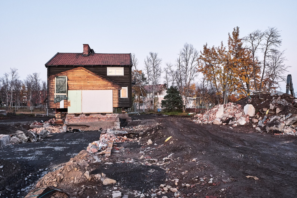 SWEDEN / Norrbottens laen / Kiruna / 26.09.2017 / Hjalmar Lundbohmsgarden, the house of city founder and first director of the mining company LKAB, Hjalmar Lundbohm. The house is dismantled and moved in three parts. This is the third part waiting to be moved to its new location at the foot of Luossavaara mountain. The missing painting shows where once part one was. © Gregor Kallina / Anzenberger