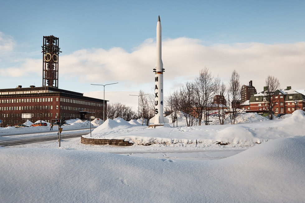 SWEDEN / Norrbottens laen / Kiruna / 11.03.2017 / A model of a rocket used at the nearby Esrange space rocket station. On the left is the Stadshuset, the city hall of Kiruna. It will be torn down except for the clocktower, which was placed next to the new city hall in 2017. © Gregor Kallina / Anzenberger