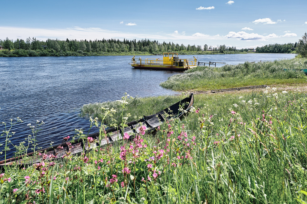 """SWEDEN / Lainio / 27.06.2019 / Car ferry to cross Lainioälven river. In 1950 about 300 inhabitants lived here, now there are not much more than 50.  Lainio belongs to the parish of Vittangi, which is looked after by the priest Jean-Claude Marclay. From my project """"Awakening"""" © Gregor Kallina"""