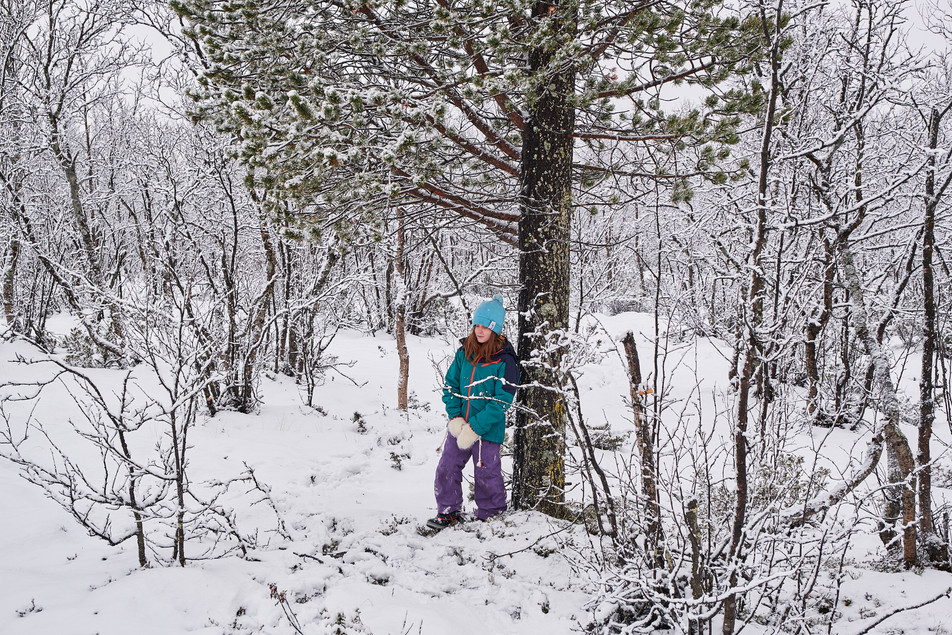 "SWEDEN / Norrbottens laen / Kiruna / 10.11.2018 / From my award-winning fotostory ""Iron Heart"". Hans-Olof Utsi's daughter Rut standing in the woods around Kiruna near Luossavaara mountain. © Gregor Kallina / Anzenberger"