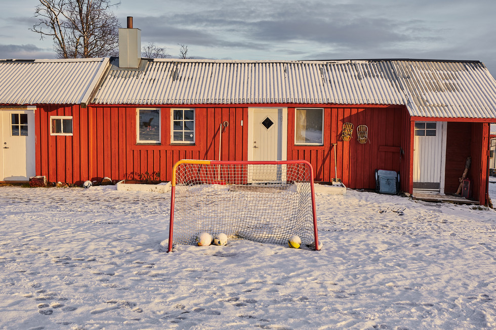 """SWEDEN / Norrbottens laen / Kiruna / 13.11.2018 / From my award-winning fotostory """"Iron Heart"""". Site of """"Kiruna Sleddog Tours"""" company, at the foot of Luossavaara mountain. Playground for employees and dogs.  © Gregor Kallina / Anzenberger"""
