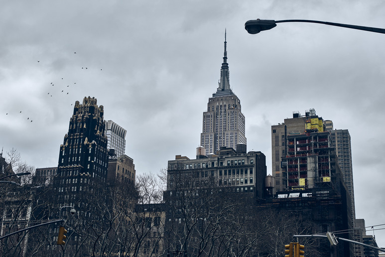 USA / New York City / 08.03.2018 / Empire State Building and Bryant Park Hotel as viewed from Bryant Park.