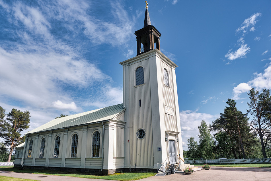 "SWEDEN / Vittangi / 24.06.2019 / The lutherian church in Vittangi, the parish of Swiss-born priest Jean-Claude Marclay, 1500 members on 6000 square kilometres in the very north of Sweden. In 1975 around 1300 people lived here, now there are not more than 800. From my project ""Awakening"". © Gregor Kallina"