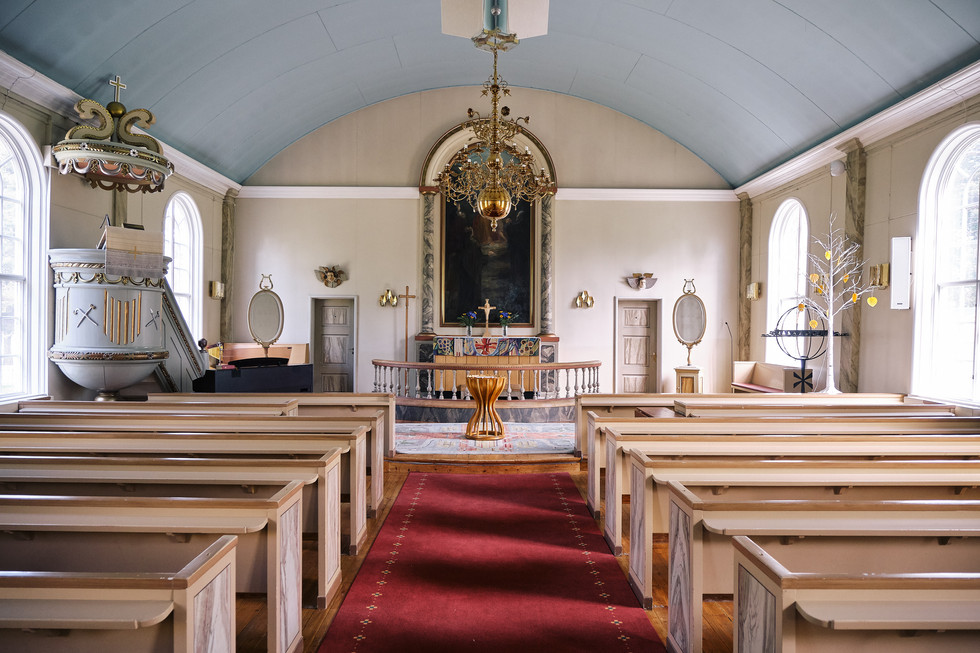 """SWEDEN / Vittangi / 24.06.2019 / The lutherian church in Vittangi, the parish of Swiss-born priest Jean-Claude Marclay, 1500 members on 6000 square kilometres in the very north of Sweden. In 1975 around 1300 people lived here, now there are not more than 800. From my project """"Awakening"""". © Gregor Kallina"""