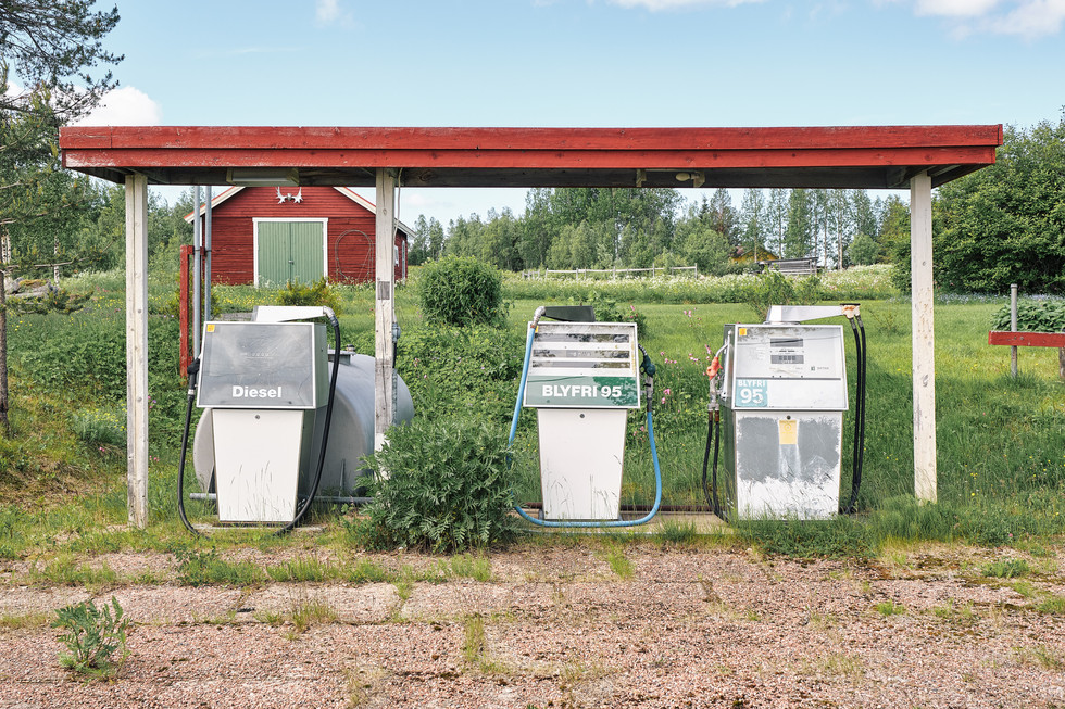 """SWEDEN / Lainio / 27.06.2019 / A petrol station in the small village of Lainio. In 1950 about 300 inhabitants lived here, now there are not much more than 50. Lainio belongs to the parish of Vittangi, which is looked after by the priest Jean-Claude Marclay. From my project """"Awakening"""" © Gregor Kallina"""