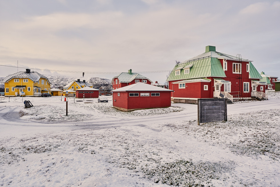 """SWEDEN / Norrbottens laen / Kiruna / 13.11.2018 /  From my award-winning fotostory """"Iron Heart"""". Typical """"bläckhorn houses"""" in Kiruna, as the buildings resemble bläckhorns, the swedish word for ink pots. The mine is in the background. © Gregor Kallina / Anzenberger"""