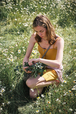 SWEDEN / Stockholm / 21.06.2019 / At Skansen, Stockholm`s open air museum. Young lady with braided birch twigs and flowers to wear them in her hair,  a typical midsummer custom in Sweden. © Gregor Kallina