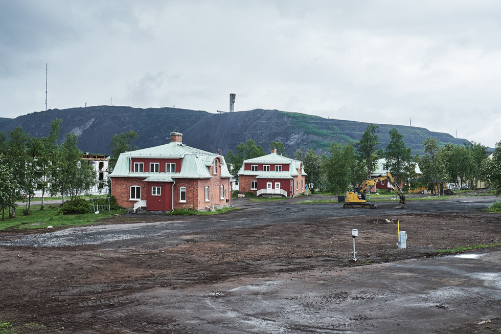 """SWEDEN / Norrbottens laen / Kiruna / 03.07.2017 / Cleaned area where some of the so called Bläckhorn houses (""""bläckhorn"""" means inkpot, which refers to the design of the house) were recently moved to their new location near Luossavaara mountain © Gregor Kallina / Anzenberger"""