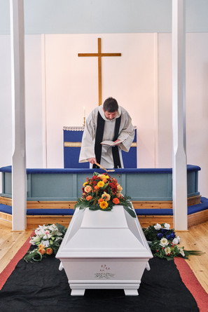 """SWEDEN / Lainio / 27.06.2019 / Priest Jean-Claude Marclay at a funeral in the small village of Lainio. In 1950 about 300 inhabitants lived here, now there are not much more than 50. Lainio belongs to the parish of Vittangi, which is looked after by Jean-Claude Marclay. From my project """"Awakening"""" © Gregor Kallina"""