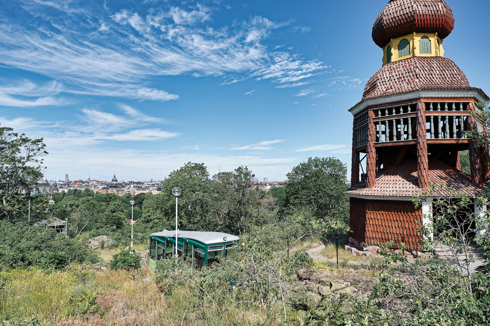 SWEDEN / Stockholm / 21.06.2019 / At Skansen, the world`s oldest open air museum, there is a funicular which you takes you up to the Tingsvallen, the venue where the Midsommar festivities take place.  The Håsjö Belfry, in the tradition of separate church towers, is watching over the funicular. © Gregor Kallina