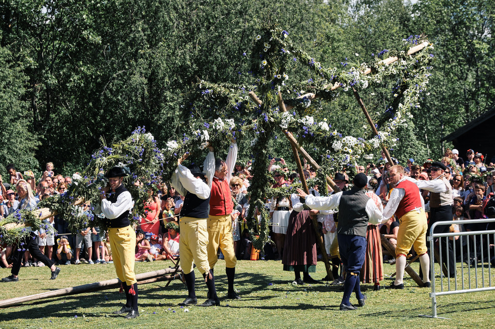 SWEDEN / Stockholm / 21.06.2019 / Midsummer festivities with one of the country-wide folk music groups, erecting the midsummer-pole at Skansen, Stockholm`s open air museum. © Gregor Kallina
