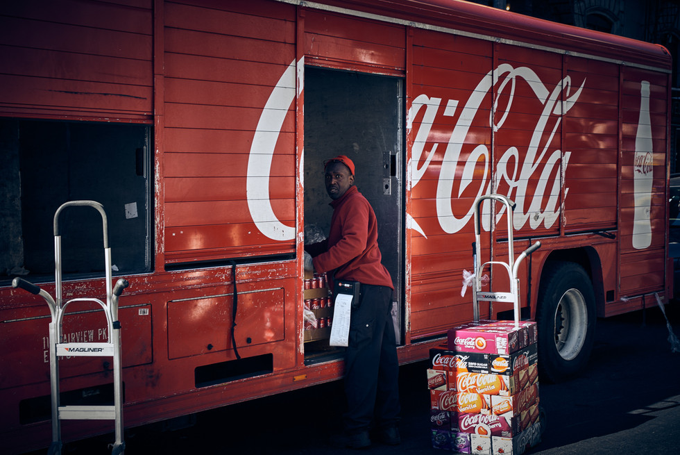 USA / New York City / 06.03.2018 /  Coca Cola delivery truck driver in East Village.