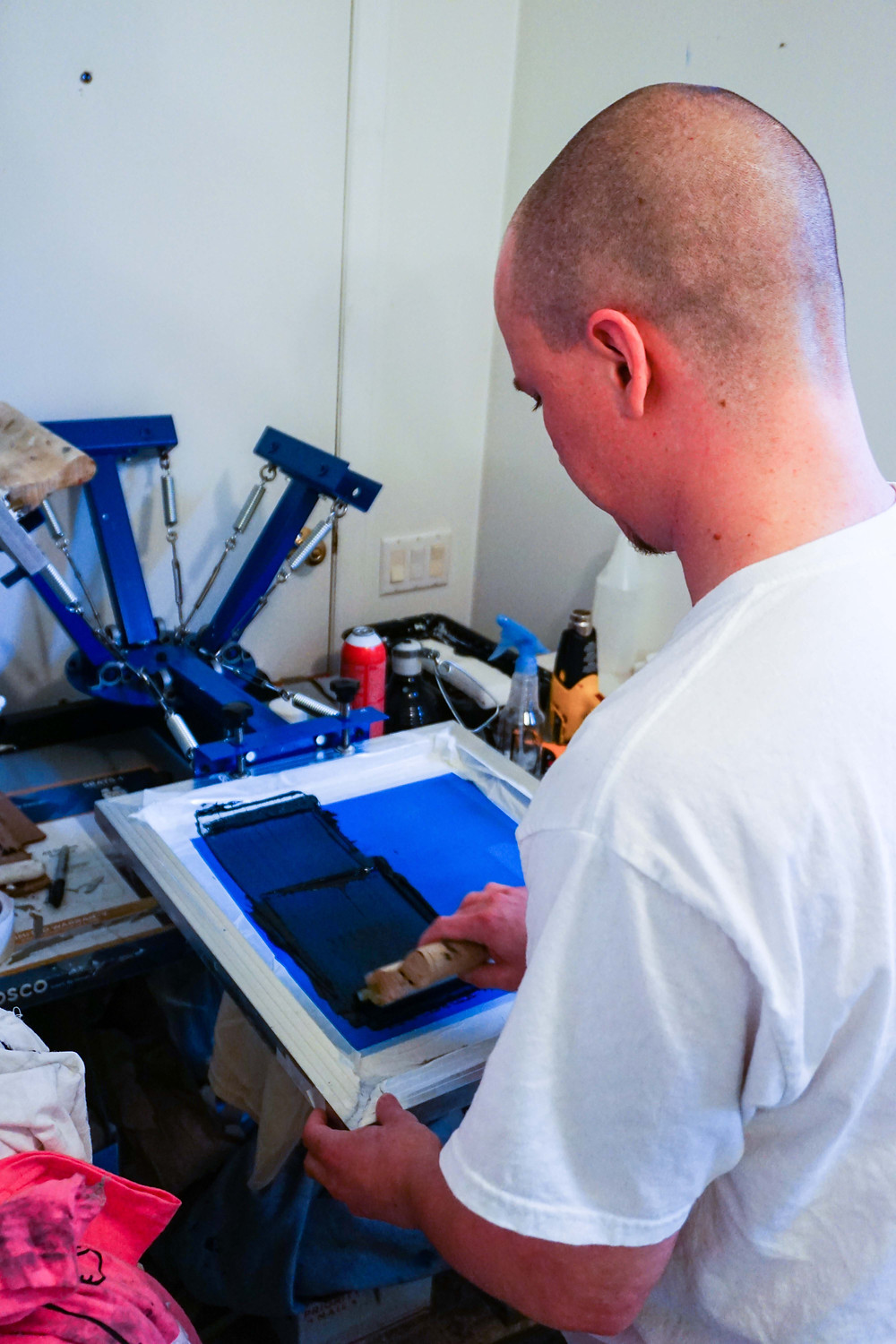 guy screen printing in house