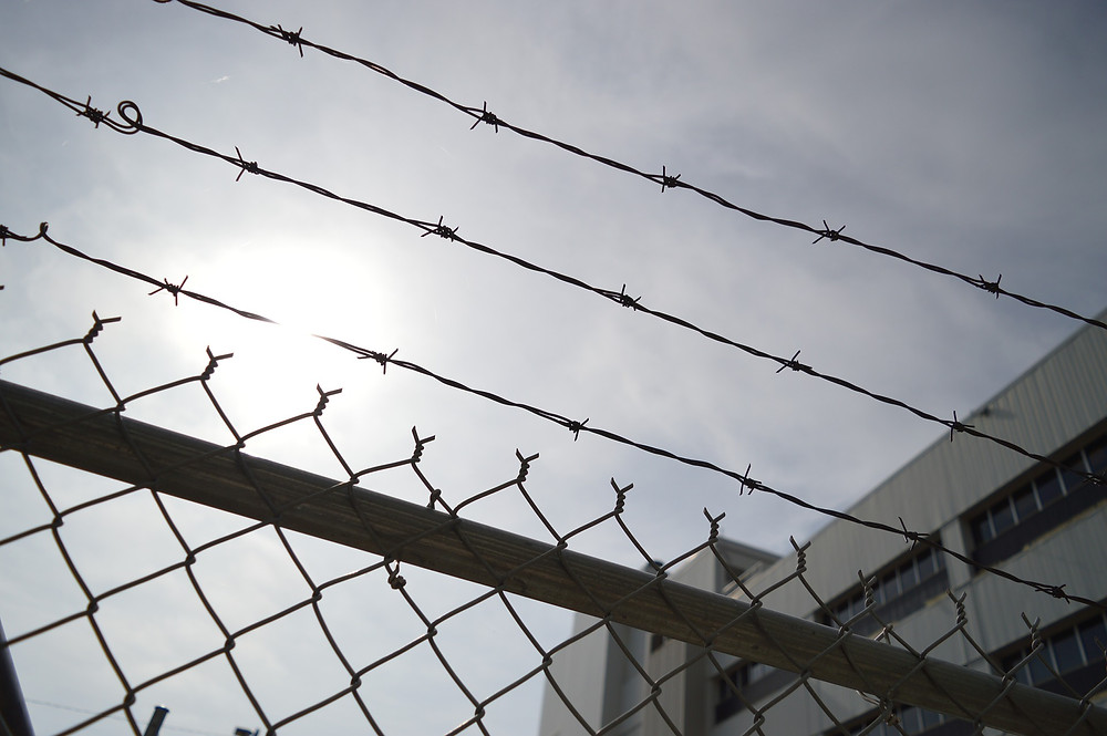 Barbed wire in front of a prison.