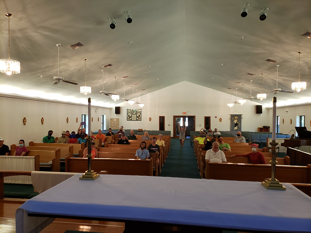 group of parishioners sitting in pews