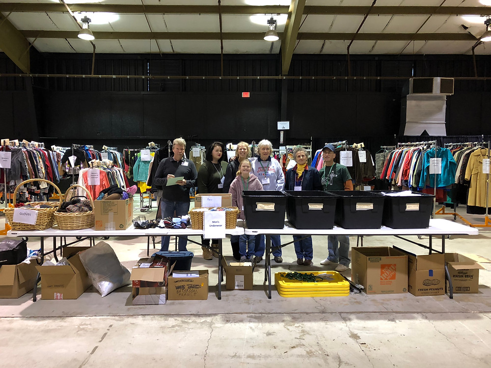 Some of the volunteers at Project Homeless Connect take a break from distributing clothing for a photo. From left, John Goff (Trinity), Charlotte Amsbaugh (Trinity), Debbie Amsbaugh (Trinity), Cecilia Archer (Redeemer), Martha Jones (Trinity), Susan Worley (Trinity) and Greg Yates (Redeemer). (Photo by Deacon Terry Goff)