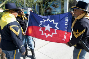 Buffalo soldiers carrying Juneteenth flag. Credit: Mary Ann White