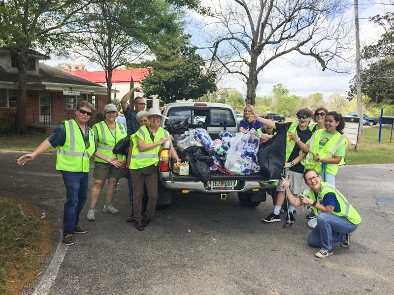 St. Monica's, Cantonment, proudly fill a pickup truck bed with trash in just 45 minutes. Photo by the Rev. Anthony MacWhinnie