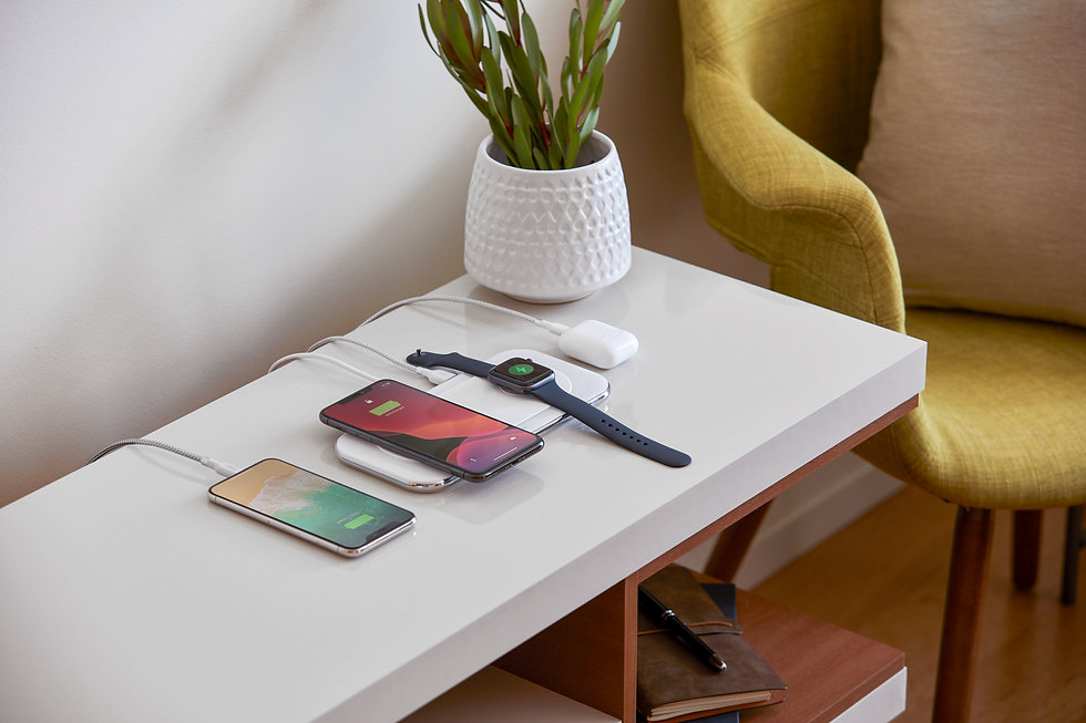 Console table with devices charging