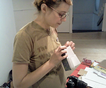 Heather Cosidetto of the Wayward School instruct a bookbinding workshopsat Off Label, Open Space artist-run centre in Victoria, BC, Canada