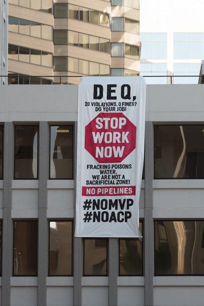 "Banner Drop on Virginia DEQ Central Office : ""STOP WORK NOW #NoMVP #NoACP"""