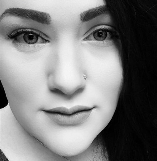 Black and white close up of Eve Liebfried of Nomd Girl Beauty