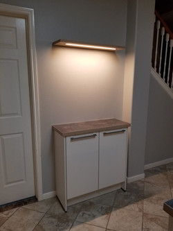 Kitchen with LED lighted wall shelf