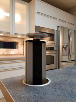 Kitchen with retractable outlet