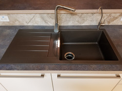 Granite kitchen sink in bronze color
