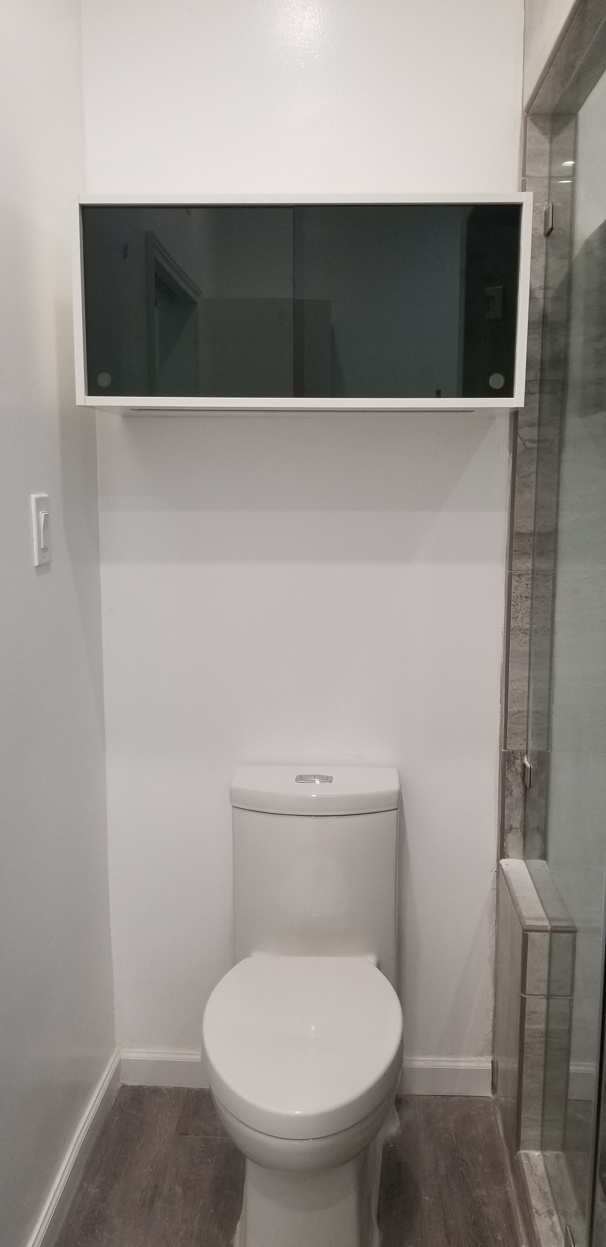 cabinets for bathroom over Toilette