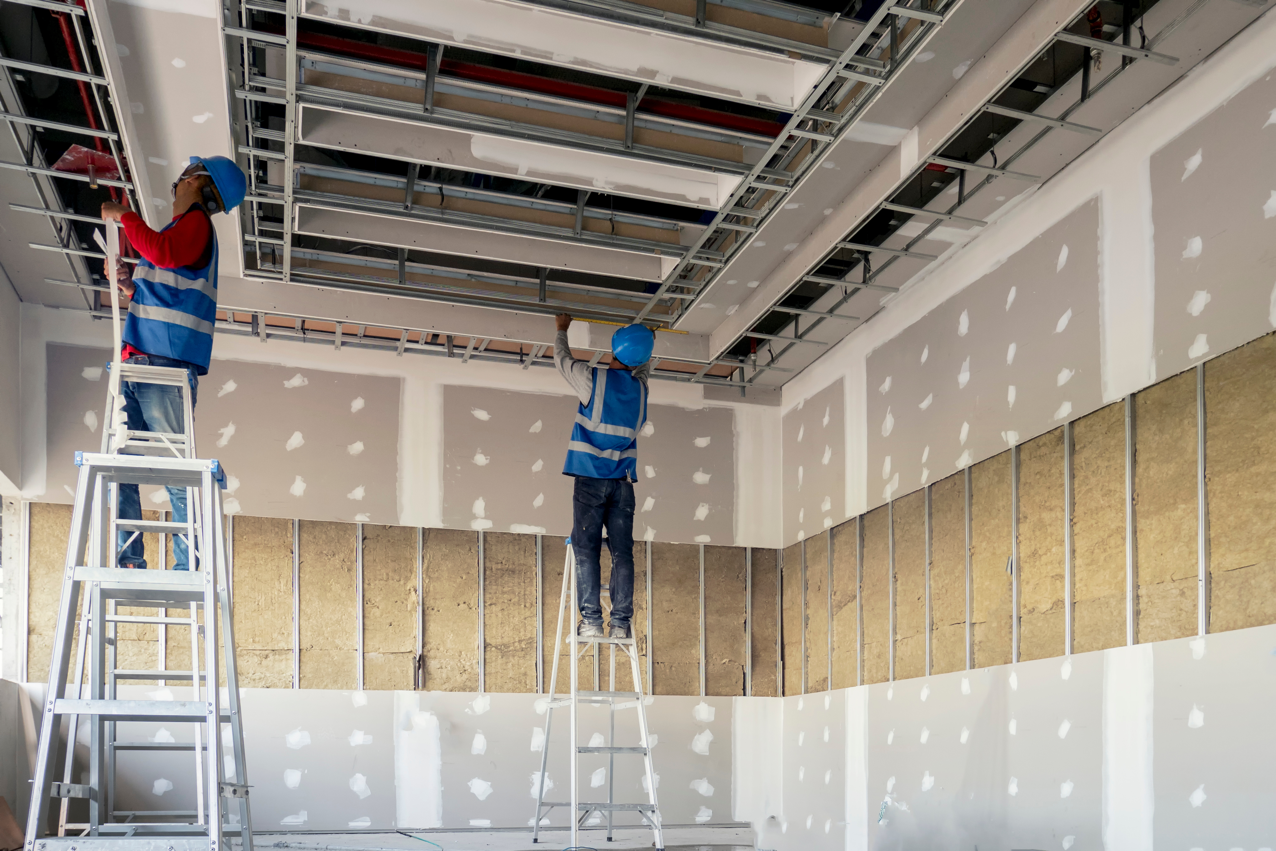Construction worker installation ceiling