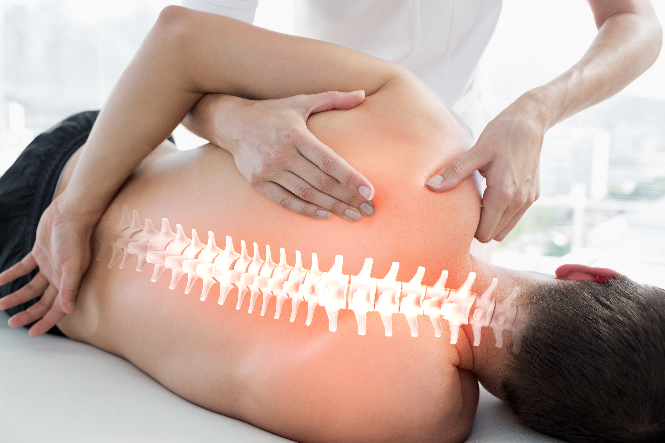 Digital composite of Highlighted bones of man at physiotherapy.jpg