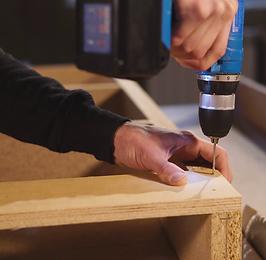 videoblocks-worker-is-making-holes-in-a-