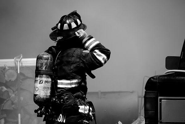 Fireman%20putting%20on%20his%20gear_edited.jpg
