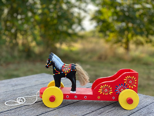 Red wooden horse and cart