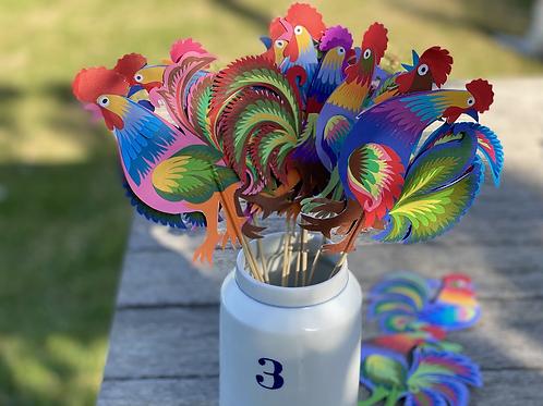 Paper cockerel decorations on a stick