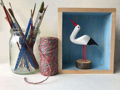 Stork in a box frame