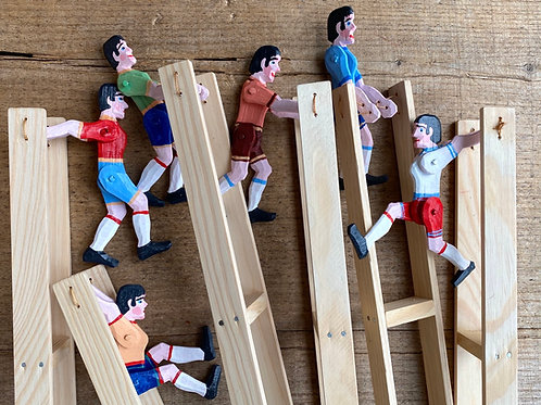 Wooden jumping man toy