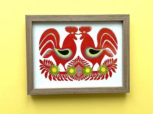 Twin cockerels paper cut, framed