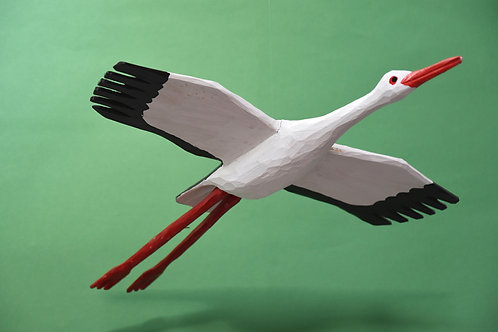Flying wooden stork