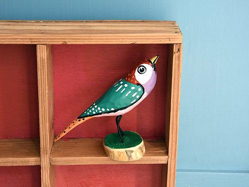 Zak Lucina green wooden bird on a stand