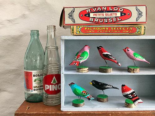 Kopek wooden bird on a stand