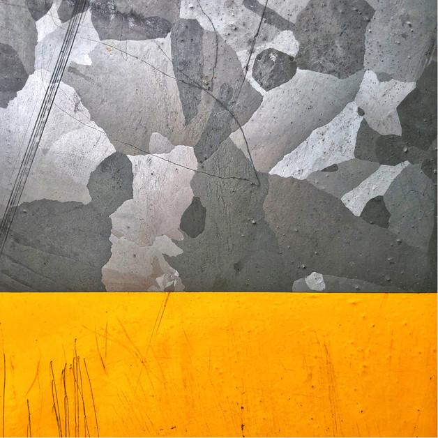 Paint on a train station galvanised steel power line.