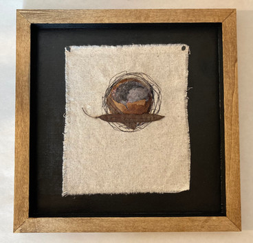 Nesting tea bag, dryer lint, red bud pods, emroidered cloth, mounted on wood $75