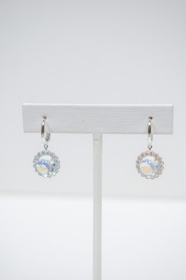Ladies 18k white gold moonstone and diamond earrings, 4.80 carat total weight round cabachon cut moonstones, .80