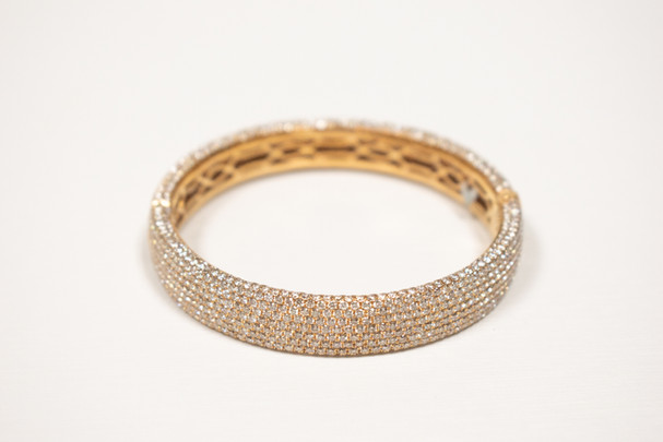 Ladies 18k white gold, hinged bangle bracelet, 16.97 carat total weight round brilliant cut diamonds.