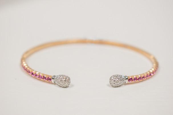 Ladies 18k white gold diamond and pink sapphire cuff bracelet, .96 carat total weight round cut pink sapphire, .50 carat total weight round brilliant cut diamonds.