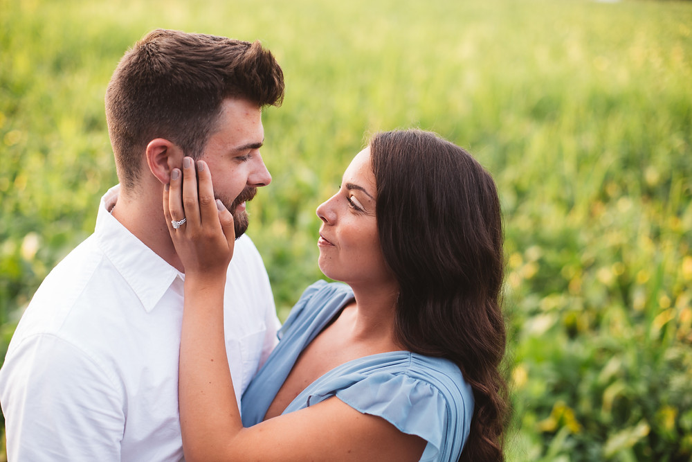 Couple posing for engagement photos at Boundary Creek Park
