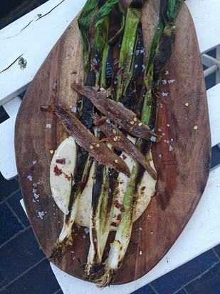 charred spring onions, leeks, anchovies, black garlic mayonnaise, chili flakes